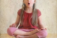 Little girl practicing yoga